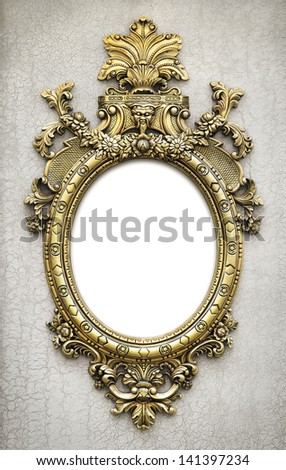 beautiful and complex golden baroque frame hanged on a textured wall - stock photo