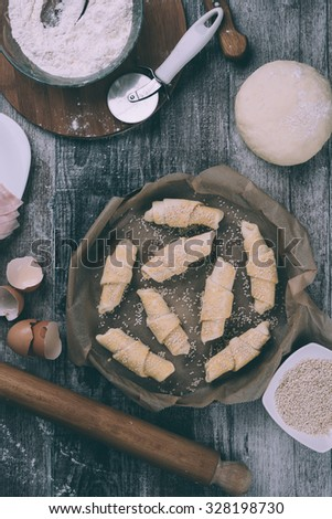 Beautiful and delicious homemade rolls with ingredients. View from above. Processed to mach old film look. - stock photo