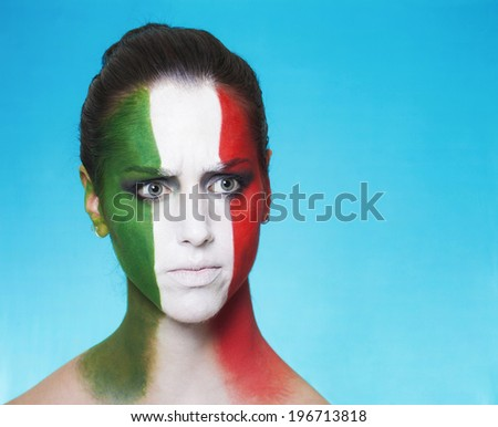 Beautiful and disappointed italian supporter looking aside