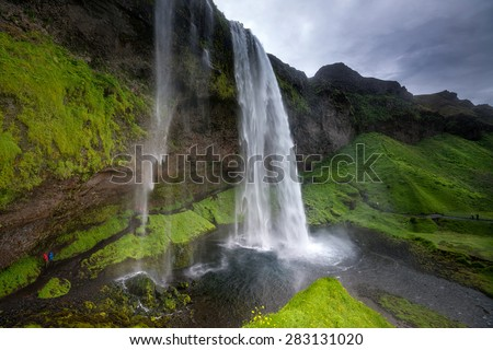 Beautiful and dramatic Seljalandsfoss waterfalls in Iceland - stock photo