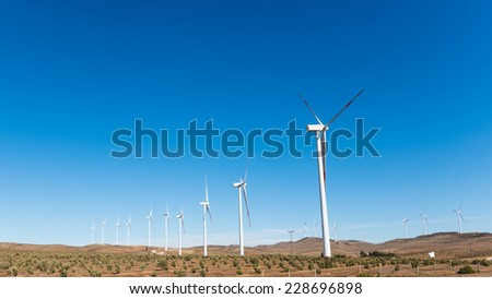 Beautiful and ecologic windmills in the north of Chile - stock photo