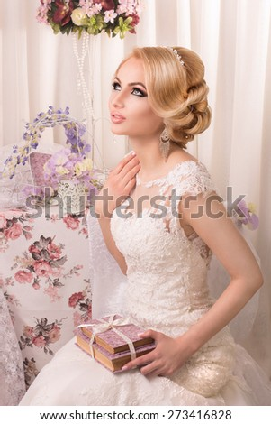 Beautiful and fashion bride in luxury interior - stock photo