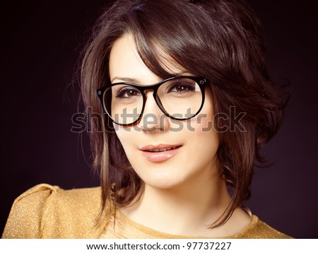 beautiful and fashion girl in glasses, close-up portrait, studio shot