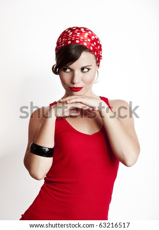 Beautiful and fashion young woman with a pin-up look - stock photo