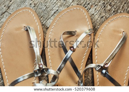 beautiful and gentle woman's sandals with silver color