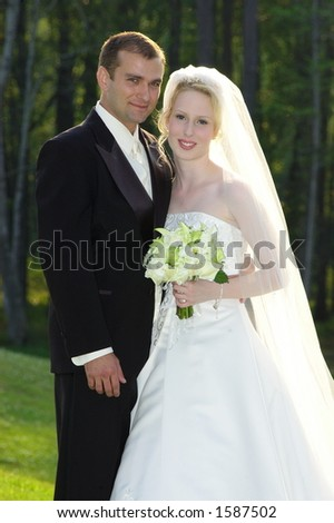 Beautiful and handsome bride and groom on their wedding day! - stock photo