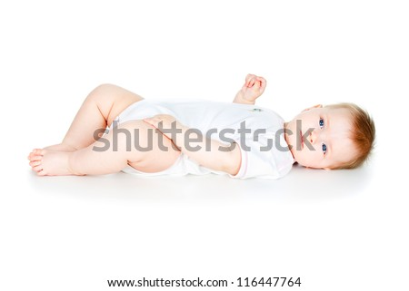 beautiful and happy baby lies isolated on a white background