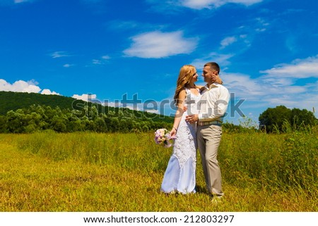 beautiful and happy bride and groom in nature