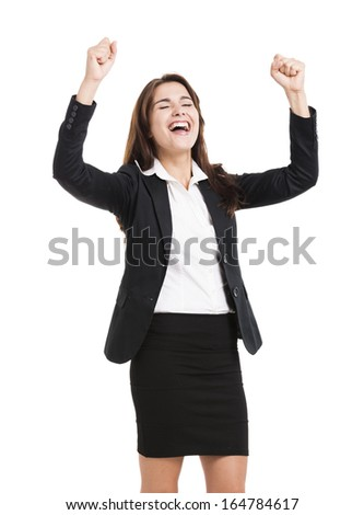 Beautiful and happy hispanic business woman with arms up, isolated over a white background