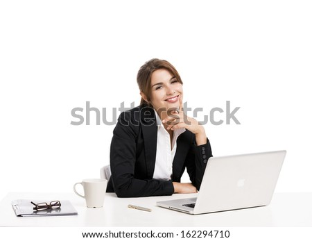 Beautiful and happy hispanic business woman working in the office, isolated over a white background - stock photo