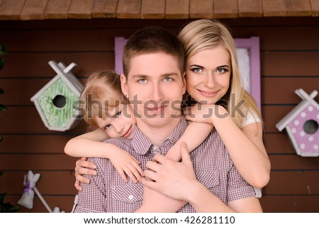 beautiful and happy smiling family, parents and daughter - stock photo