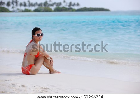 beautiful and happy woman girl on beach have fun and relax on summer vacation  over the sea