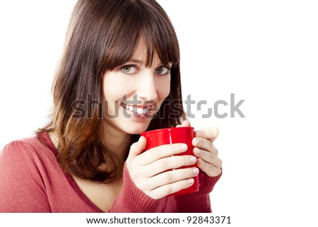 Beautiful and happy woman holding a cup of coffee, isolated on a white background