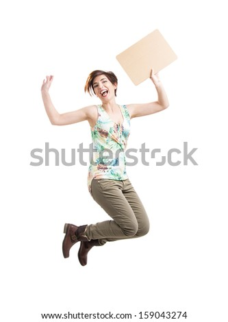 Beautiful and happy woman jumping and holding a cardboard, isolated over a white background - stock photo