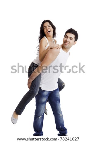 Beautiful and happy young couple standing over a white background