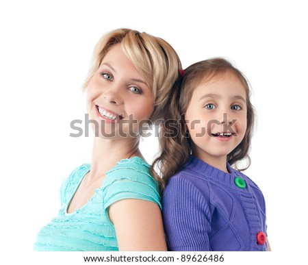 beautiful and happy young mother and small daughter smiling and looking into the camera. Back to back in studio, isolated on white background - stock photo