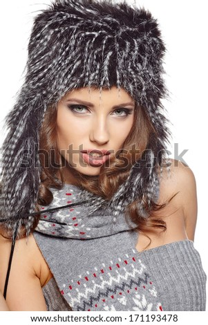 Beautiful and happy young woman isolated on white and wearing a fur hat
