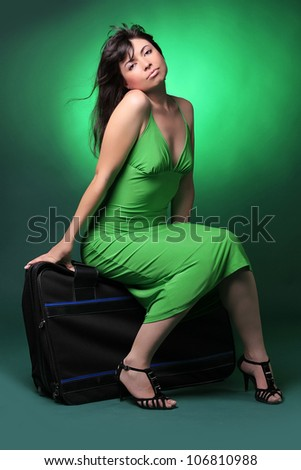 Beautiful and happy young woman with an old suitcase isolated on white background - stock photo