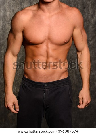 Beautiful and health athletic caucasian muscular young man.  - stock photo