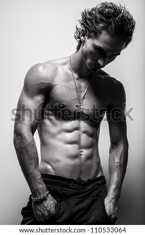 Beautiful and health athletic caucasian muscular young man. Black-white photo.
