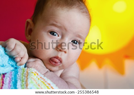 Beautiful and healthy baby peeking at her mother - stock photo