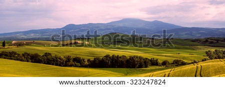Beautiful and miraculous colors of green spring panorama landscape of Tuscany. Italy - stock photo