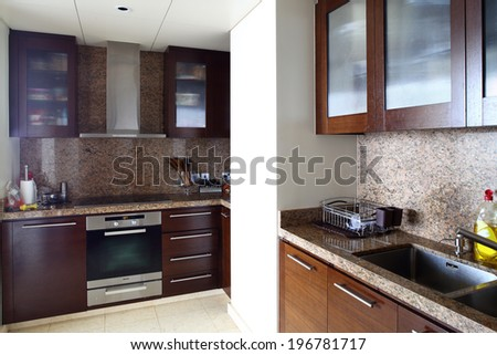 beautiful and model interior of bright kitchen