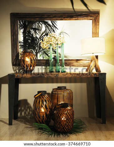 beautiful and moderns lamps and for outdoor with a mirror and a vase on a wooden buffet on a studio photography - stock photo