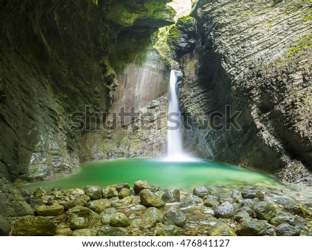 beautiful and mysterious waterfall in a cave, waterfall Kozjak, Kobarid, Slovenia
