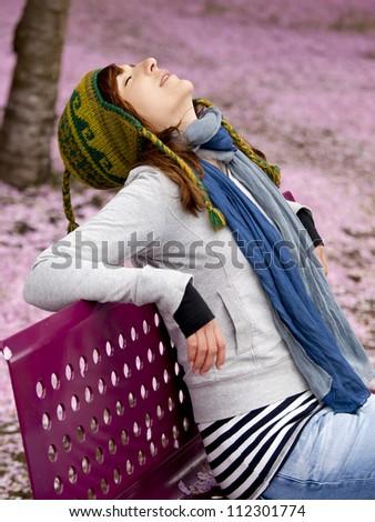 Beautiful and natural girl enjoying the autumn season - stock photo