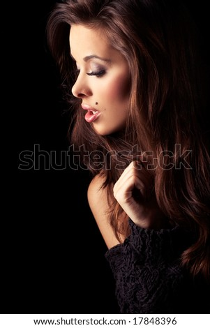 beautiful and sexy brunette girl on dark background - portrait