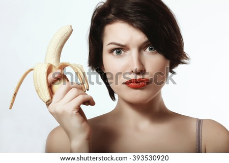 beautiful and sexy brunette with a banana in his hand - stock photo
