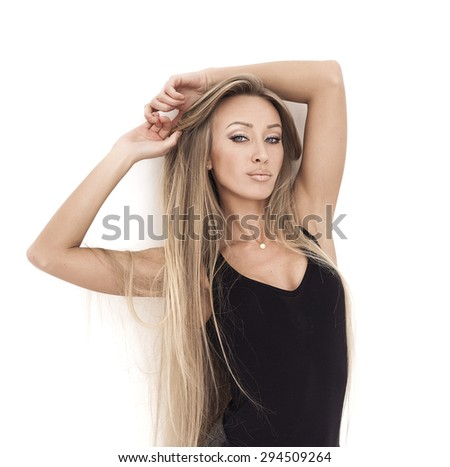 Beautiful and sexy girl with gorgeous hair posing