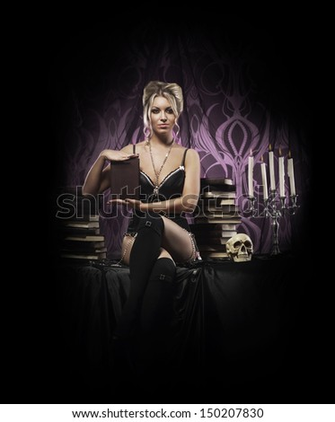 Beautiful and sexy witch in sexy lingerie posing in gothic interior - stock photo