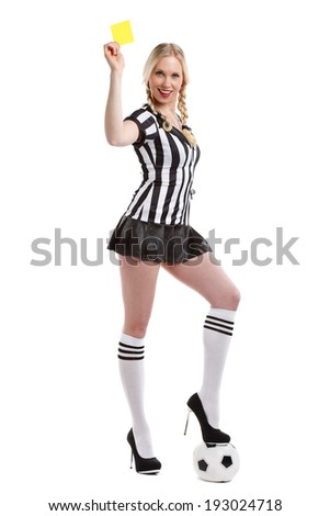 beautiful and sexy woman is holding her yellow card up and is standing on a ball - stock photo