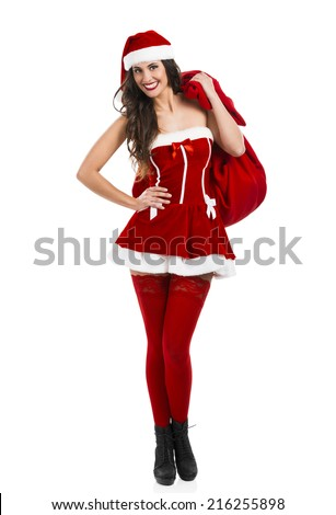 Beautiful and sexy woman wearing santa claus costume and carrying a bag full of presents - stock photo