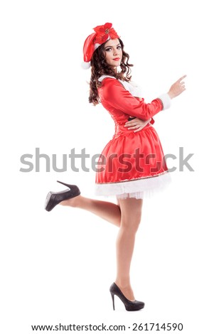 Beautiful and sexy woman wearing santa clause costume isolated on white - stock photo