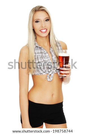 Beautiful and sexy young blond woman holding glass of beer - stock photo