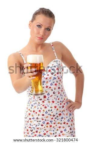 Beautiful and sexy young woman holding glass of beer - stock photo