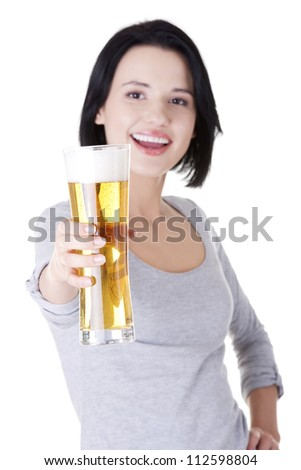 Beautiful and sexy young woman with beer, isolated on white - stock photo