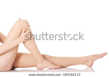 Beautiful and smooth woman's perfect legs with fresh skin. Isolated on white.