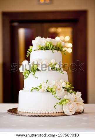Beautiful and tasty wedding cake at wedding reception - stock photo