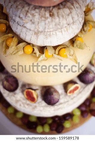 Beautiful and tasty wedding cake at wedding reception - stock photo