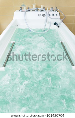 beautiful and white jacuzzi filled with water - stock photo