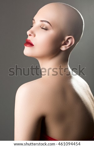 beautiful and young, bald woman struggling with cancer, strong and self-confident