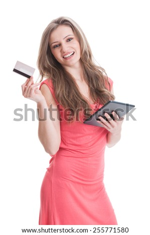Beautiful and young girl buying online using credit or debit card and a wireless tablet - stock photo