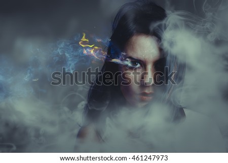 Beautiful anger, girl with burning eye, smoke
