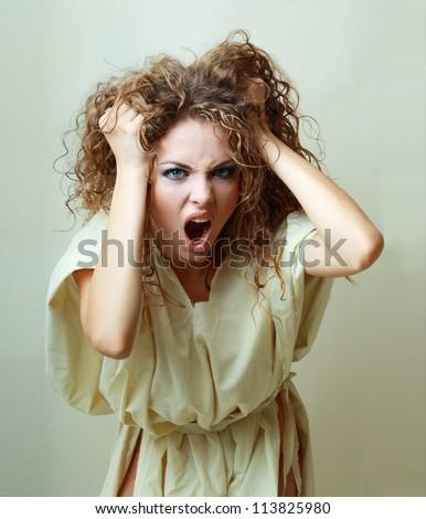 Beautiful angry insane psychopath woman  screaming - stock photo