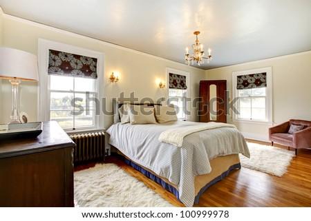 Beautiful antique elegant bedroom interior. - stock photo
