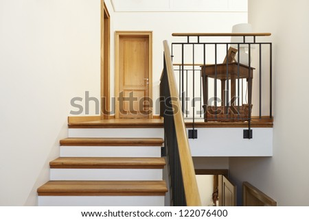 beautiful apartment, interior, wooden staircase - stock photo